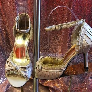 Champagne patent, ruffle heels.